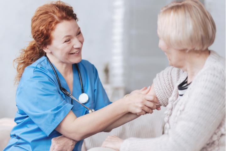 Happy nurse checking on a patient